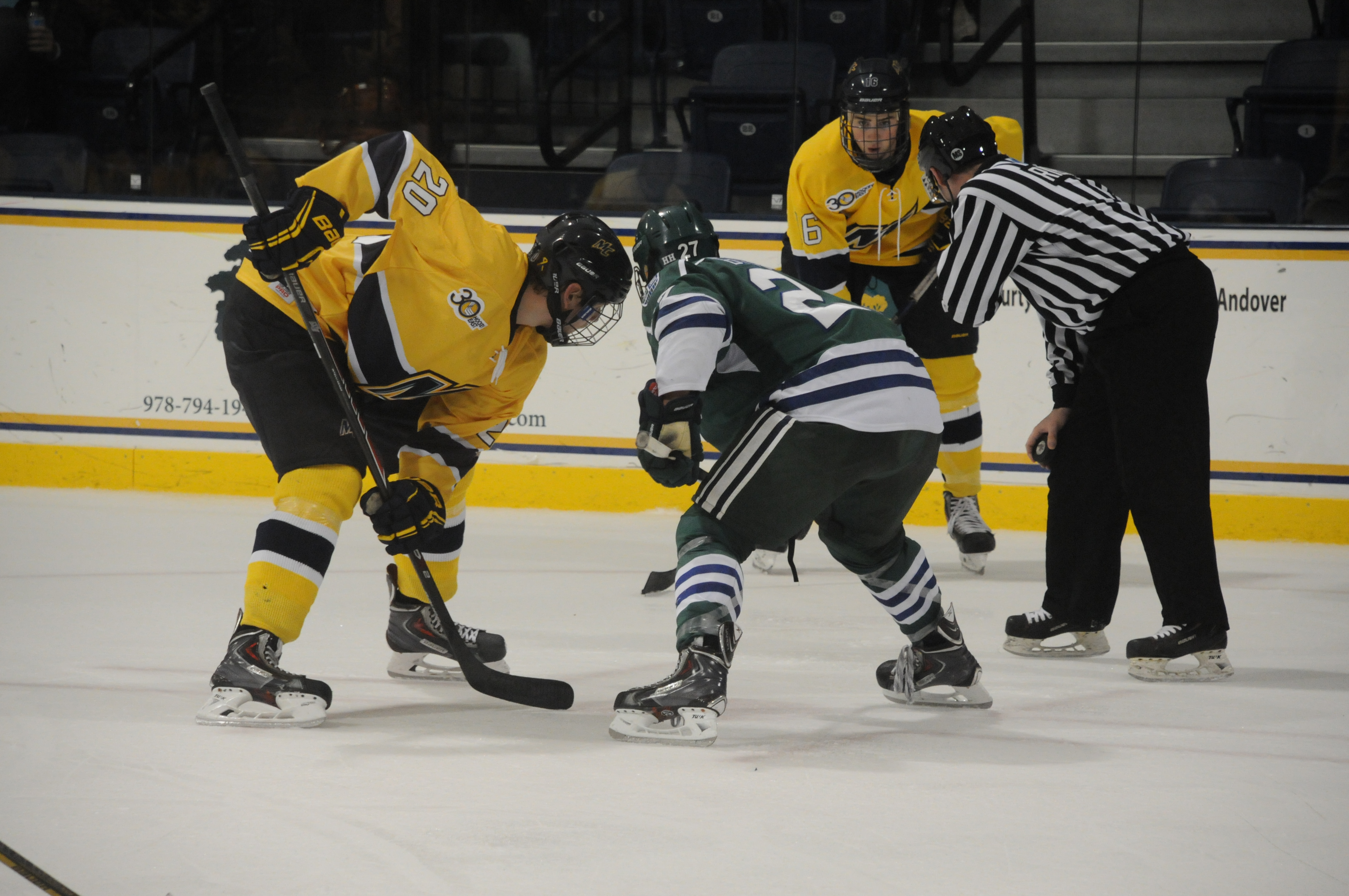 Freshman centerman Hampus Gustafsson prepares to take a faceoff against Mercyhurst as senior defenseman Thomas McCarthy looks on. Photo by Kelli Readey '16