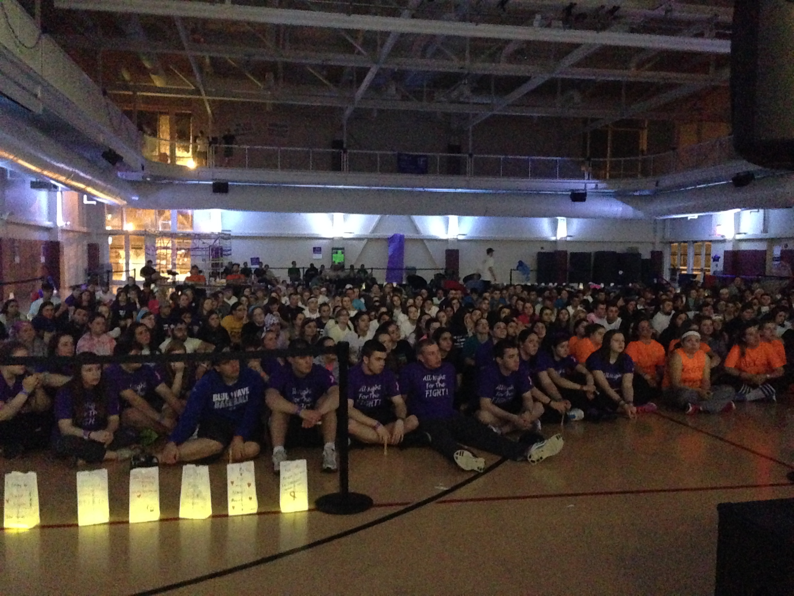Relay For Life participants listen to the heartfelt speech Dr. Warren Kay and his wife Nancy Kay gave during the Luminaria Ceremony